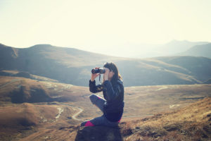 woman-looking-landscape-binoculars
